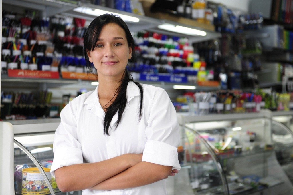 small business: happy owner of a stationery shop